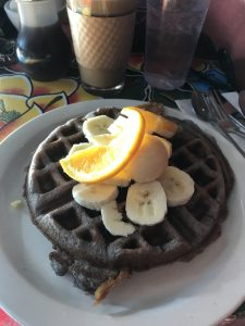 Belgian waffle, plate sized, distinctive violet gray color from blue cornmeal